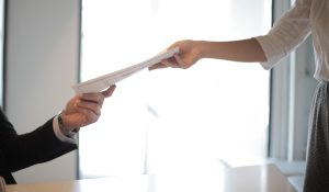 job-applicant-passing-her-documents-3760072 (1)